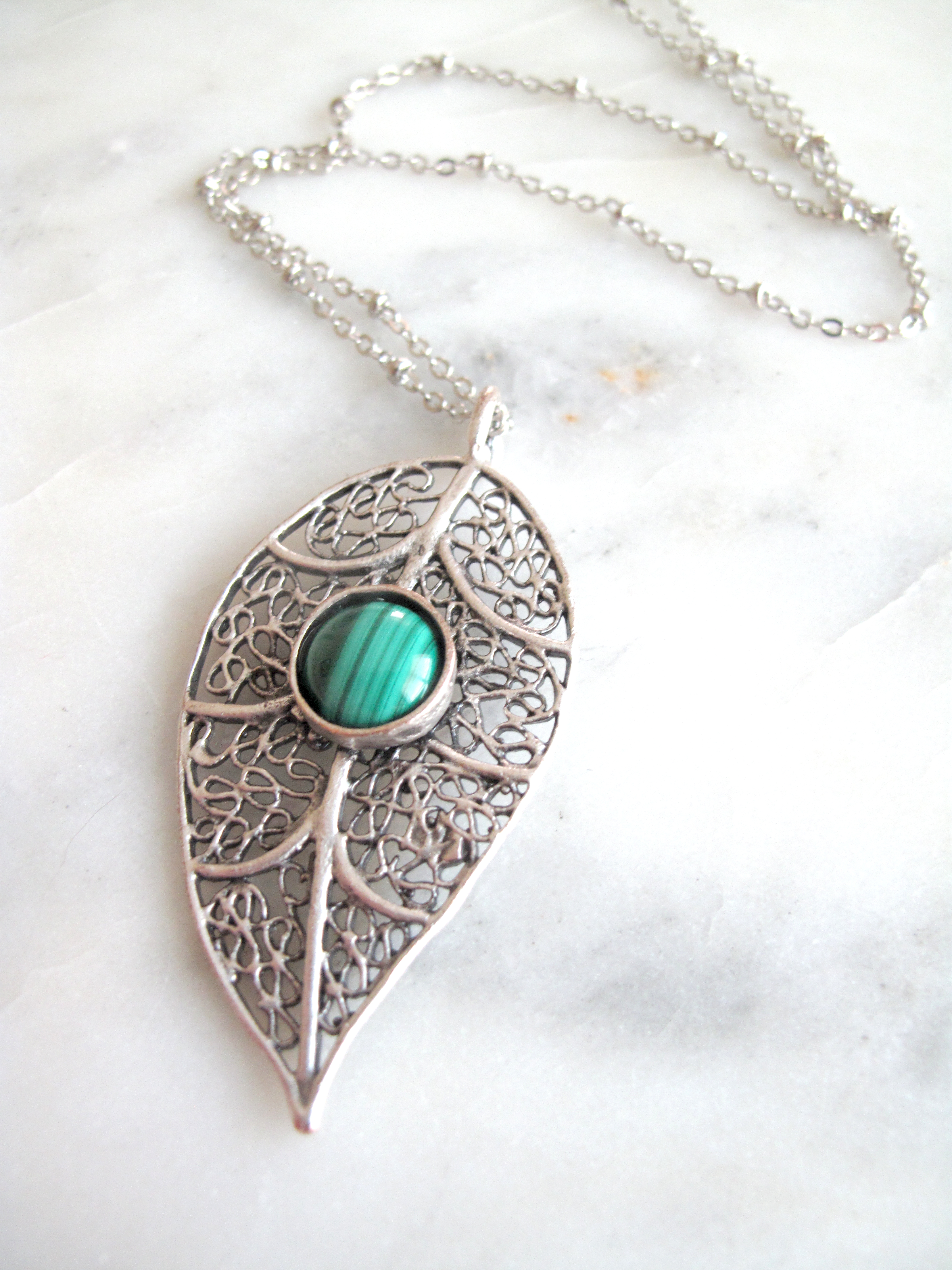 https://www.aprilalayne.com/shop/shopping/yugen-detailed-leaf-with-turquoise-drop-necklace/