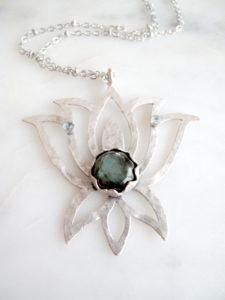 https://www.aprilalayne.com/shop/shopping/yugen-lotus-bloom-necklace/