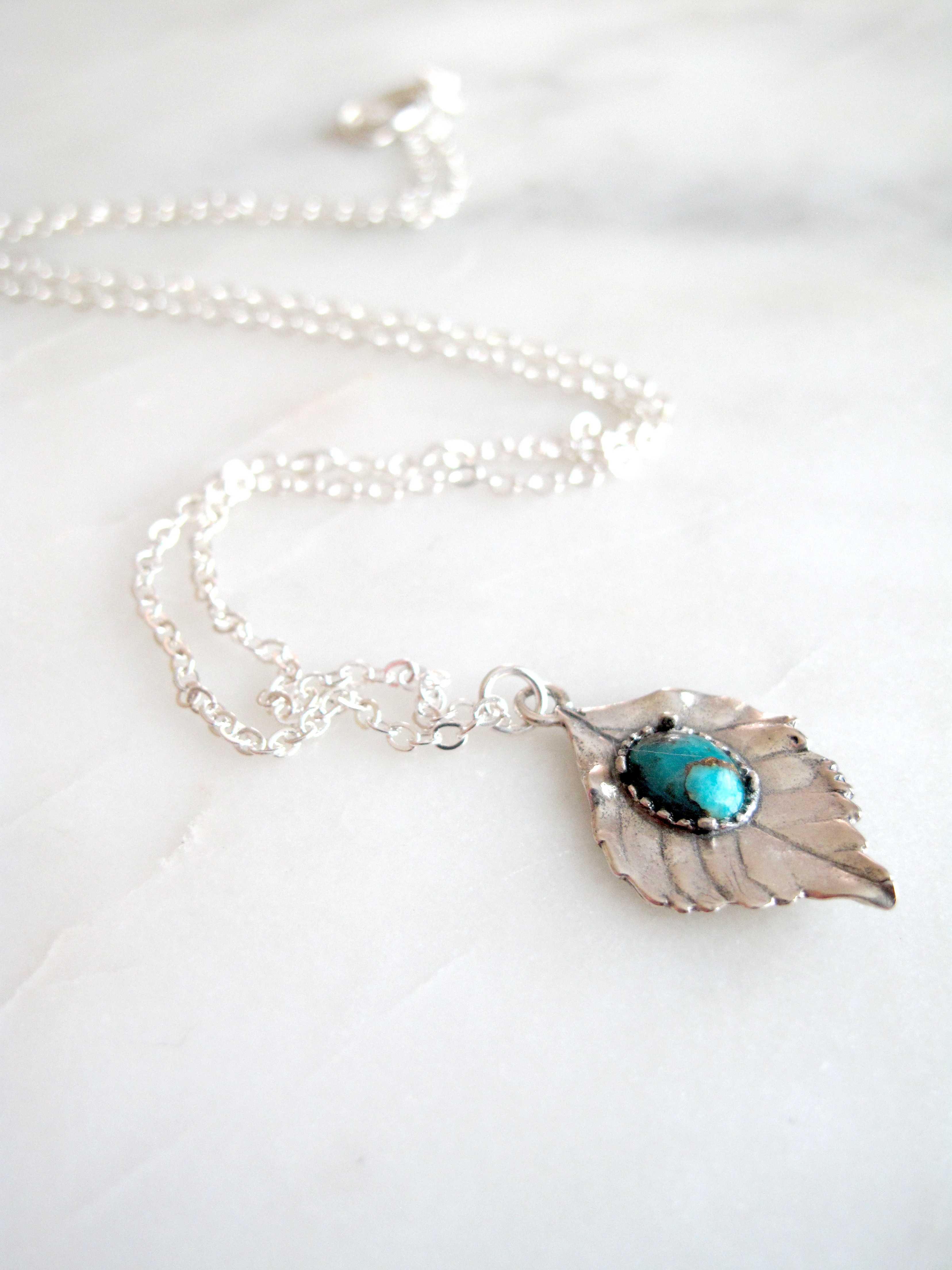 https://www.aprilalayne.com/shop/shopping/yugen-leaf-with-turquoise-drop-necklace/